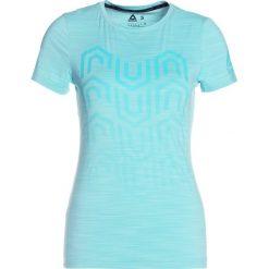 Reebok Tshirt z nadrukiem turquoise. Niebieskie topy sportowe damskie marki Reebok, m, z nadrukiem, z elastanu. W wyprzedaży za 135,20 zł.