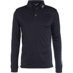 J.LINDEBERG TOUR TECH SLIM Koszulka polo navy melange. Niebieskie koszulki polo J.LINDEBERG, l, z materiału. W wyprzedaży za 265,30 zł.