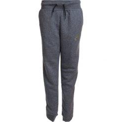 Nike Performance PANT Spodnie treningowe carbon heather/anthracite. Szare spodnie chłopięce Nike Performance, z bawełny. W wyprzedaży za 170,10 zł.