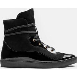 29174d214a0a2 Czarne sneakersy damskie. Czarne buty sportowe damskie Kazar, z  aplikacjami, ze skóry,