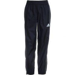 Adidas Performance CORE Spodnie treningowe black/white. Niebieskie spodnie chłopięce marki Retour Jeans, z bawełny. Za 129,00 zł.