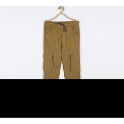 Spodnie. Brązowe chinosy chłopięce SPEEDWAY, z bawełny. Za 99,90 zł.