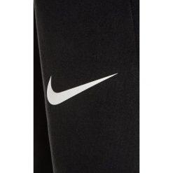Nike Performance DRY HYPER FLEECE Spodnie treningowe black/white. Czarne spodnie chłopięce Nike Performance, z elastanu. W wyprzedaży za 129,35 zł.