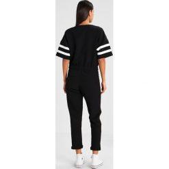 GStar SPORT Kombinezon daek black. Czarne kombinezony damskie marki G-Star, s, z elastanu, sportowe. W wyprzedaży za 629,85 zł.