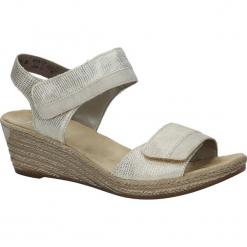 Złote sandały na koturnie Rieker 62470-90. Czarne sandały damskie marki Rieker, z materiału. Za 218,99 zł.