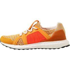 Adidas by Stella McCartney ULTRA BOOST Obuwie do biegania treningowe gold/rusora/turbo. Żółte buty do biegania damskie adidas by Stella McCartney, z materiału. Za 899,00 zł.