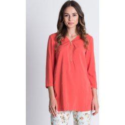 Luźna bluzka z suwakiem przy dekolcie BIALCON. Pomarańczowe bluzki longsleeves marki BIALCON, w jednolite wzory, z materiału, wizytowe. W wyprzedaży za 84,00 zł.