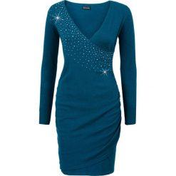 Sukienka dzianinowa z aplikacją ze sztrasów bonprix niebieskozielony morski. Brązowe sukienki dzianinowe marki Mohito, l, z kopertowym dekoltem, kopertowe. Za 49,99 zł.