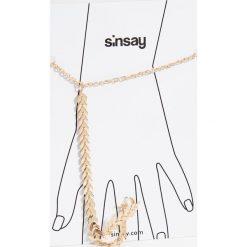 Bransoletki damskie na nogę: Bransoletka z pierścionkiem - Beżowy
