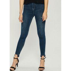 Jeansy skinny z wysokim stanem - Granatowy. Niebieskie spodnie z wysokim stanem marki Sinsay, z jeansu. Za 79,99 zł.