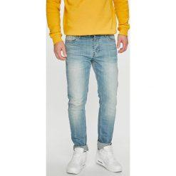 Dickies - Jeansy. Szare jeansy męskie z dziurami marki Dickies, z bawełny. Za 299,90 zł.