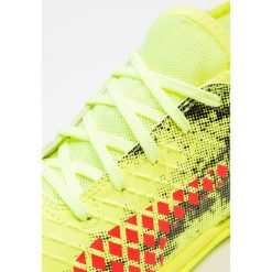 Puma FUTURE 18.4 IT Halówki fizzy yellow/red blast/black. Żółte buty skate męskie Puma, z materiału. Za 189,00 zł.