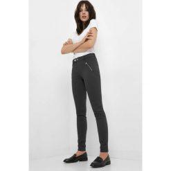 Spodnie skinny z zamkami. Żółte rurki damskie marki Orsay, s, z bawełny, z golfem. Za 129,99 zł.