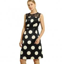 Sukienka w kolorze czarno-białym. Białe sukienki na komunię marki Almatrichi, s, w kropki, z dekoltem na plecach, midi, proste. W wyprzedaży za 199,95 zł.
