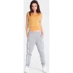 Naoko - Spodnie Best Things Gris. Szare bryczesy damskie marki NAOKO, l, z elastanu, casualowe. W wyprzedaży za 119,90 zł.