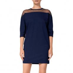 Sukienka w kolorze ciemnoniebieskim. Niebieskie sukienki mini marki BOHOBOCO, z dekoltem na plecach, proste. W wyprzedaży za 689,95 zł.