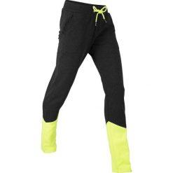 Spodnie dresowe, długie, z kolekcji Maite Kelly, Level 1 bonprix czarno-żółty neonowy melanż. Czarne spodnie sportowe damskie marki bonprix, z dresówki, na fitness i siłownię. Za 74,99 zł.