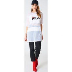 FILA Sukienka typu t-shirt Emily - White. Białe sukienki mini marki Fila, l, z meshu, sportowe, z krótkim rękawem, sportowe. W wyprzedaży za 128,77 zł.