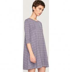 Sukienka z rozkloszowanym dołem - Fioletowy. Fioletowe sukienki rozkloszowane marki Reserved, l. Za 79,99 zł.