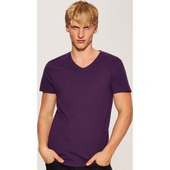 T-shirt basic - Fioletowy. Czarne t-shirty męskie marki KIPSTA, z poliesteru, do piłki nożnej. Za 25,99 zł.