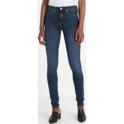 Calvin Klein Jeans CKJ 011 MID RISE SKINNY  Jeans Skinny Fit amsterdam blue mid. Niebieskie jeansy damskie relaxed fit Calvin Klein Jeans, z bawełny. Za 449,00 zł.