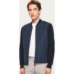 Żakardowy sweter z pikowanym przodem - Granatowy. Niebieskie swetry klasyczne męskie marki QUECHUA, m, z elastanu. Za 189,99 zł.