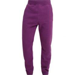 Napapijri MACAU Spodnie treningowe mid purple. Szare spodnie dresowe męskie marki Napapijri, l, z materiału, z kapturem. Za 389,00 zł.