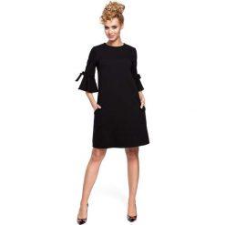Sukienki dzianinowe: Czarna Sukienka Trapezowa z Rozkloszowanymi Rękawami