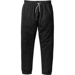 Spodnie dresowe bonprix czarny. Spodnie dresowe męskie marki bonprix, z dresówki. Za 69,99 zł.