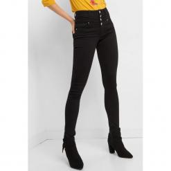 Jeansy skinny z wysokim stanem. Czarne jeansy damskie skinny marki Orsay, xs, z bawełny, z dekoltem na plecach. Za 139,99 zł.