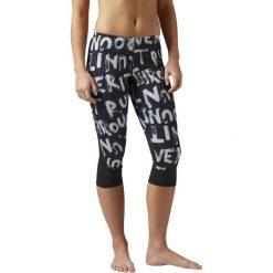 Spodnie dresowe damskie: Reebok Spodnie Essentials Capri Tight 3/4 czarno-białe r. XS (BK7223)