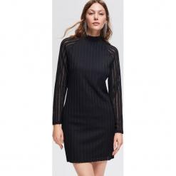 Sukienka ze stójką - Czarny. Czarne sukienki marki Reserved, l, ze stójką. Za 89,99 zł.