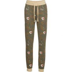 Spodnie dresowe bonprix oliwkowy moro. Brązowe spodnie dresowe damskie marki DOMYOS, xs, z bawełny. Za 99,99 zł.