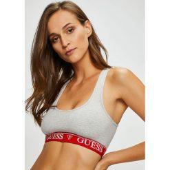 Guess Jeans - Biustonosz. Szare biustonosze sportowe marki Guess Jeans, na co dzień, l, z aplikacjami, z bawełny, casualowe, z okrągłym kołnierzem, mini, dopasowane. Za 119,90 zł.