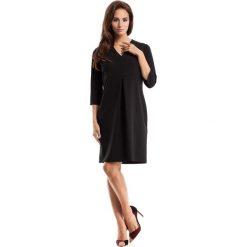 Czarna Sukienka Wizytowa z Fałdą na Przodzie. Czarne sukienki dzianinowe marki bonprix, do pracy, w paski, biznesowe, moda ciążowa. Za 119,90 zł.