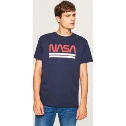 T-shirt z nadrukiem NASA - Granatowy. Niebieskie t-shirty męskie z nadrukiem marki QUECHUA, m, z elastanu. Za 59,99 zł.