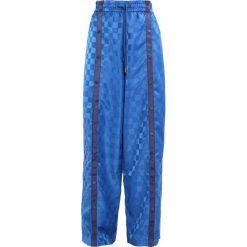 Fenty PUMA by Rihanna TEARAWAY TRACK Spodnie treningowe bright cobalt/evening blue. Niebieskie spodnie dresowe damskie Fenty PUMA by Rihanna, s, z materiału. W wyprzedaży za 395,45 zł.