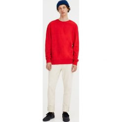 Bluza basic z okrągłym dekoltem. Czerwone bluzy męskie rozpinane marki KALENJI, m, z elastanu, z długim rękawem, długie. Za 34,90 zł.