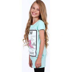 Tunika dziewczęca z aplikacją miętowa NDZ8178. Zielone sukienki dziewczęce z falbanami Fasardi, z aplikacjami. Za 39,00 zł.