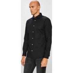 Jack & Jones - Koszula. Czarne koszule męskie na spinki Jack & Jones, l, z bawełny, z klasycznym kołnierzykiem, z długim rękawem. W wyprzedaży za 89,90 zł.