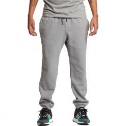 Spodnie dresowe w kolorze szarym. Szare spodnie dresowe męskie Adidas, Reebok, z dresówki. W wyprzedaży za 157,95 zł.
