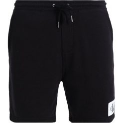 Calvin Klein Jeans HOMEROS SLIM Spodnie treningowe black. Czarne jeansy męskie Calvin Klein Jeans. Za 299,00 zł.