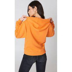 NA-KD Basic Bluza z kapturem basic - Orange. Różowe bluzy z kapturem damskie marki NA-KD Basic, prążkowane. Za 100,95 zł.