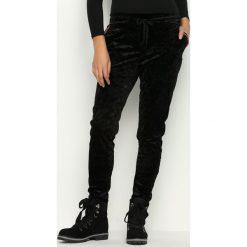 Spodnie dresowe damskie: Czarne Spodnie Dresowe Glowing