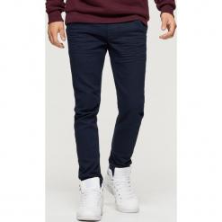 Jeansy SLIM JOGGER - Niebieski. Niebieskie jeansy męskie regular Cropp. Za 119,99 zł.