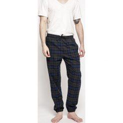 Emporio Armani - Spodnie piżamowe. Szare piżamy męskie marki Emporio Armani, l, z nadrukiem, z bawełny, z okrągłym kołnierzem. W wyprzedaży za 159,90 zł.