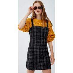 Sukienka na ramiączkach w kratkę. Niebieskie sukienki na komunię marki bonprix, z nadrukiem, na ramiączkach. Za 79,90 zł.