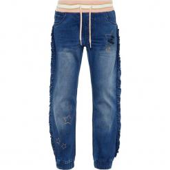 """Dżinsy """"Rie"""" - Regular fit - w kolorze niebieskim. Niebieskie jeansy dziewczęce marki Name it Kids, z materiału. W wyprzedaży za 65,95 zł."""