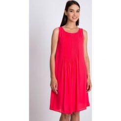 Sukienki: Koralowa rozkloszowana sukienka QUIOSQUE