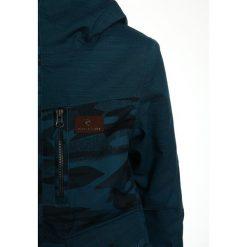 Rip Curl SNAKE Kurtka narciarska ink blue. Niebieskie kurtki chłopięce sportowe marki Rip Curl, z materiału, narciarskie. W wyprzedaży za 353,40 zł.